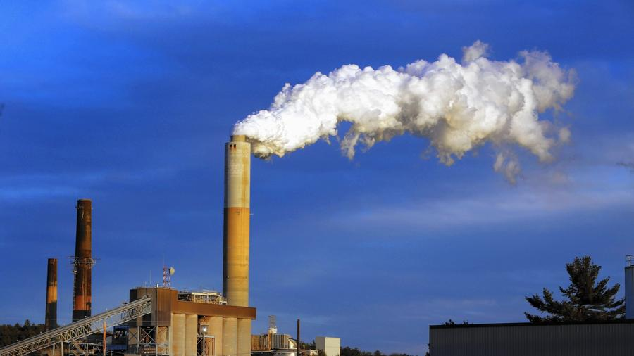 Steam billows from the coal-fired Merrimack Station in Bow, N.H. President Obama's Clean Power Plan poses significant challenges for states that rely on coal-fired power plants for much of their electricity. (Jim Cole / Associated Press)
