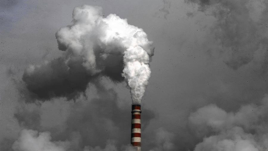 Under new promises, the cities of Beijing and Guangzhou are committing to start tapering their carbon dioxide emissions by the end of 2020. Above, smoke rises from a coal-fired Chinese power plant in 2009. (Andy Wong / Associated Press)